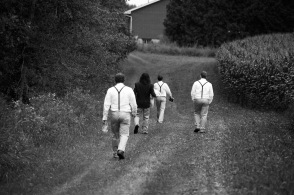 The boys walking to the aisle in the woods.