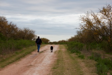 Owner and dog following fishing.