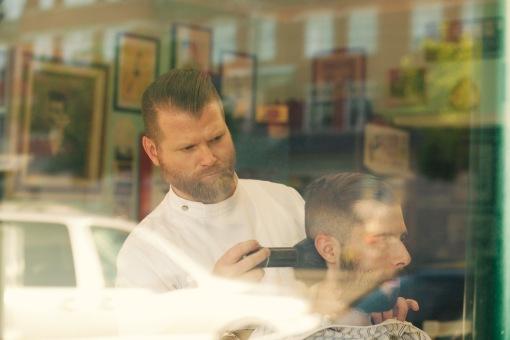 Simon, barber at Nite Owl Barber Shop.