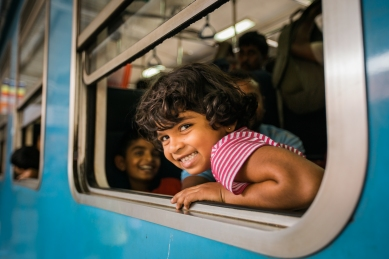 Girl Riding Train in Sri Lanka