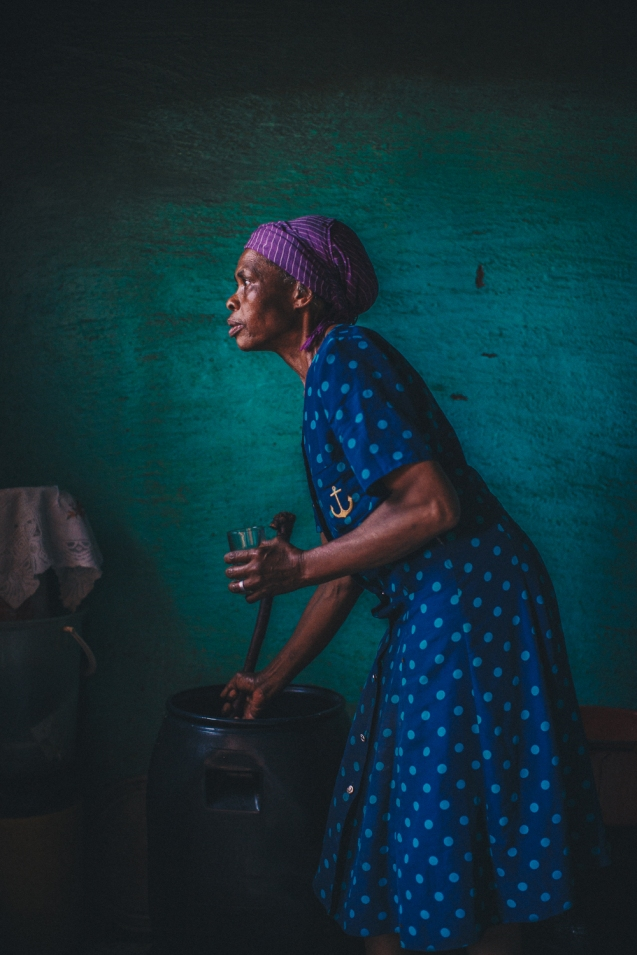 A woman stirs her homemade beer in Lesotho, Africa