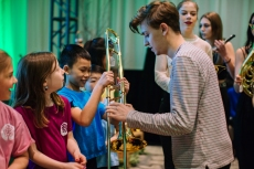 Scott Helman handing out new instruments for Music Counts