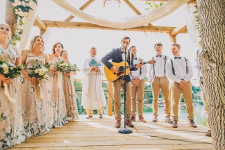 When the Groom plays an original song when the Bride comes.
